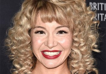 Katherine Castro Medium Curly Casual    Hairstyle with Blunt Cut Bangs  -  Blonde Hair Color