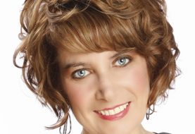Short Curly Formal    Hairstyle with Side Swept Bangs  -  Chestnut Brunette Hair Color with  Blonde Highlights